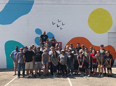 VMLers helped give Wonderscope Children's Museum new energy with an outdoor mural, matching the creativity the organization inspires inside the building
